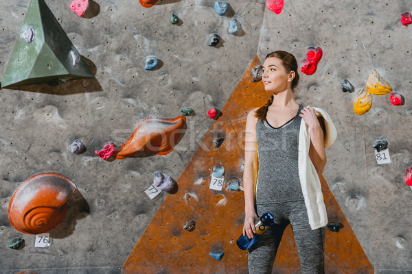 young woman in front of climbing wall Stock photo © LightFieldStudios