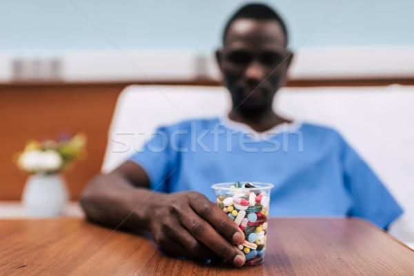pills in plastic glass Stock photo © LightFieldStudios