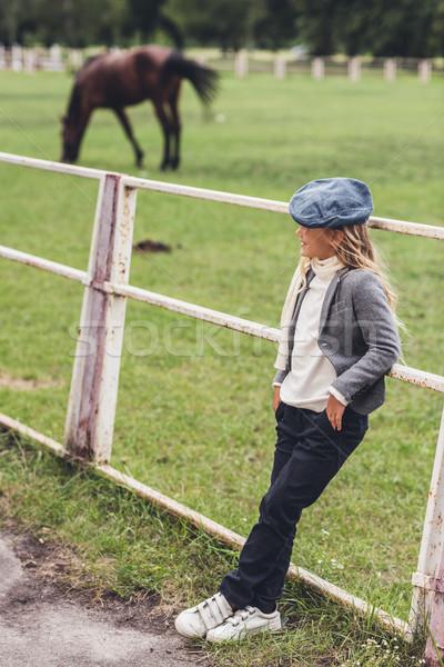 child at paddock with horse Stock photo © LightFieldStudios