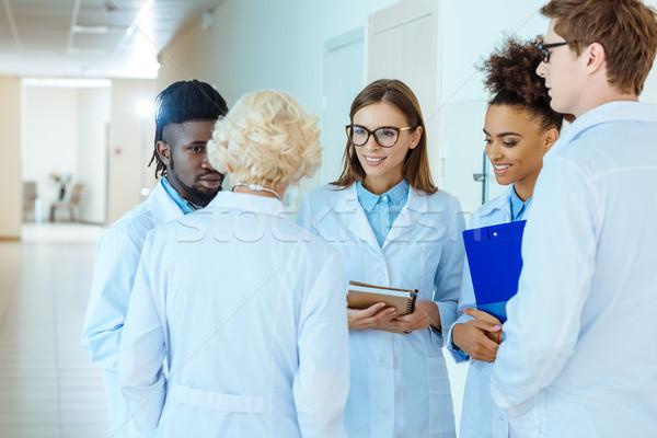 medical interns discussing work Stock photo © LightFieldStudios