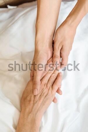 Women holding hands Stock photo © LightFieldStudios