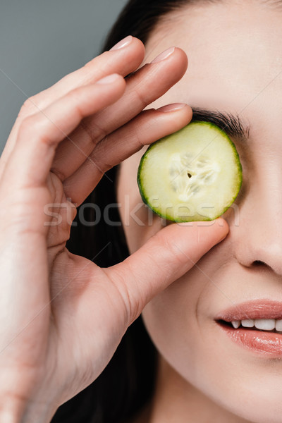 Vrouw plakje komkommer oog shot Stockfoto © LightFieldStudios