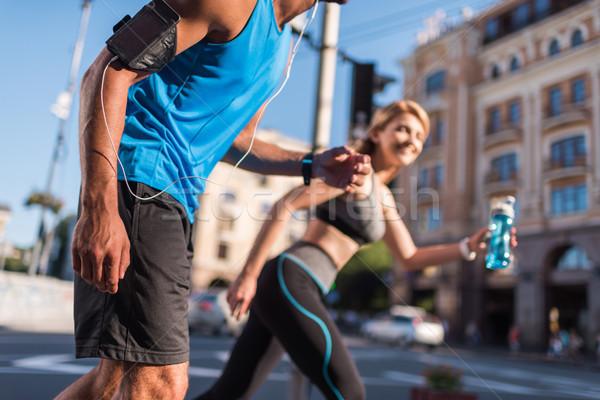 sportswoman and sportsman jogging in city Stock photo © LightFieldStudios