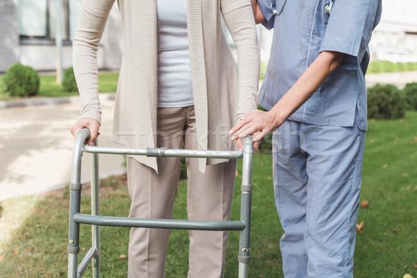 nurse and senior patient with walker Stock photo © LightFieldStudios