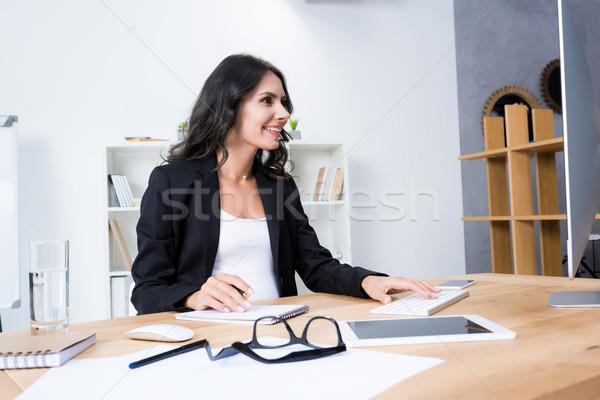 pregnant businesswoman working with computer Stock photo © LightFieldStudios
