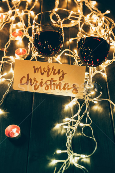 Stock photo: Wineglasses and merry christmas card