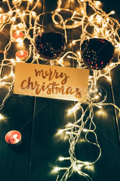 Borospoharak vidám karácsonyi üdvözlet kettő szemüveg vörösbor Stock fotó © LightFieldStudios