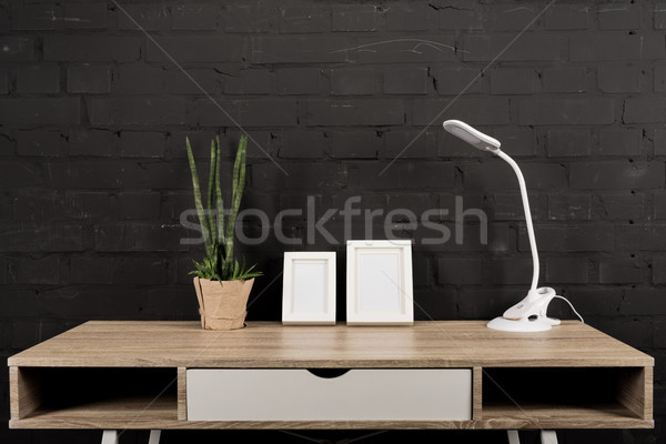 empty photo frames and table lamp Stock photo © LightFieldStudios