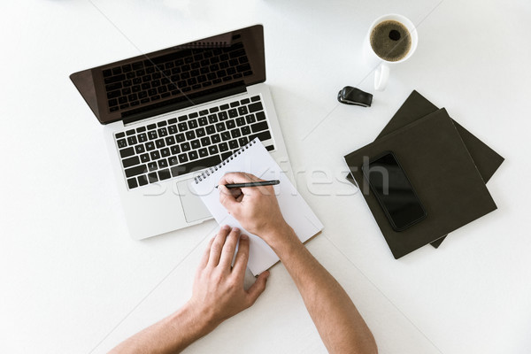 male hands writing in notebook Stock photo © LightFieldStudios