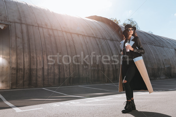 Woman in autumn outfit standing with milk shake Stock photo © LightFieldStudios