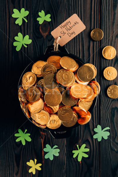 top view of pot with golden coins and shamrock on wooden table, st patricks day concept Stock photo © LightFieldStudios