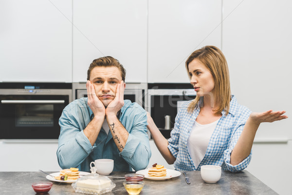 portrait of couple having argument during breakfast at home Stock photo © LightFieldStudios