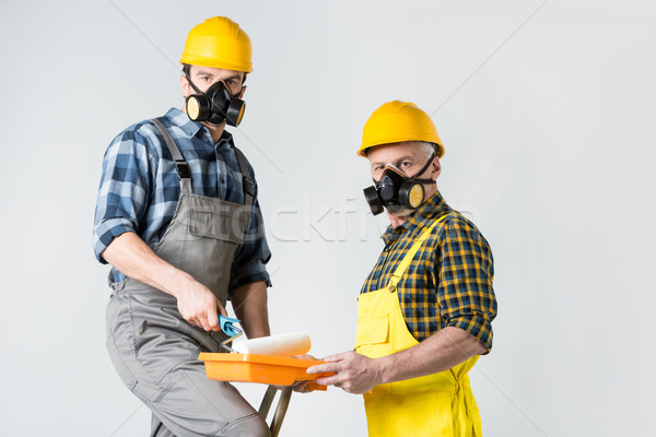 Workmen with paint roller Stock photo © LightFieldStudios