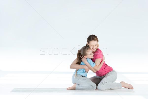Mutlu anne kız oturma yoga mat Stok fotoğraf © LightFieldStudios