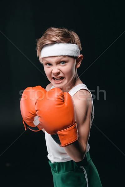 Portré fiú boxkesztyűk izolált fekete aktív Stock fotó © LightFieldStudios