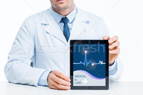 Doctor with digital tablet Stock photo © LightFieldStudios