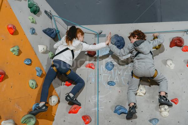 Kids high-fiving on climbing wall Stock photo © LightFieldStudios