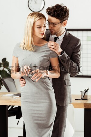 Couple embracing in office Stock photo © LightFieldStudios
