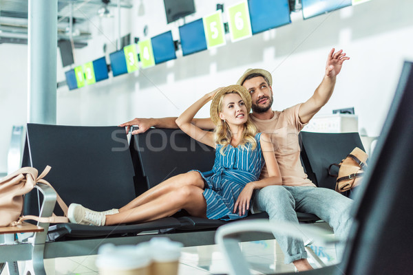 couple waiting for boarding at airport Stock photo © LightFieldStudios