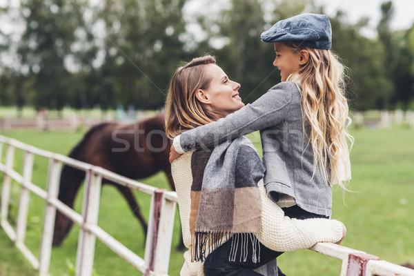 family at paddock with horse  Stock photo © LightFieldStudios