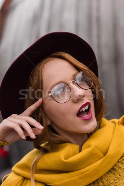 Heyecanlı kız gözlük çekici şık Stok fotoğraf © LightFieldStudios