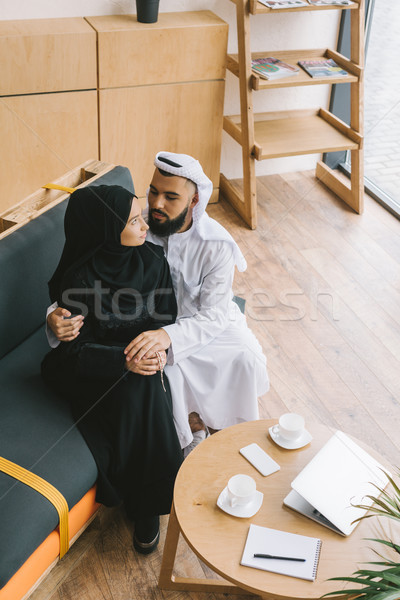 muslim couple embracing on couch Stock photo © LightFieldStudios