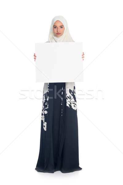 muslim woman holding blank board Stock photo © LightFieldStudios