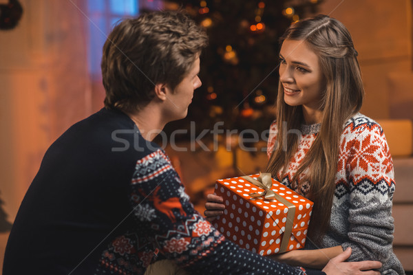 couple with christmas present Stock photo © LightFieldStudios