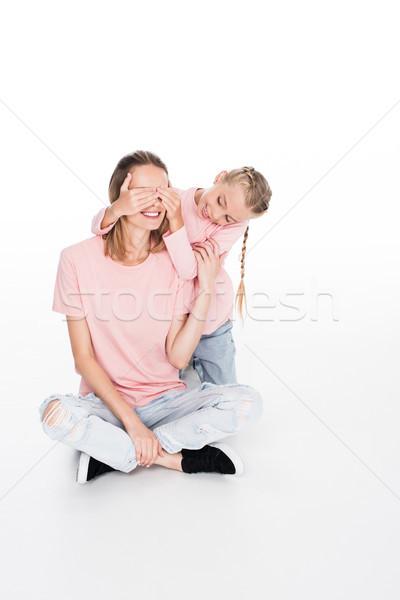 daughter closing eyes to her mother Stock photo © LightFieldStudios
