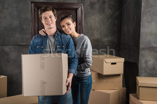 couple with cardboard box at new home Stock photo © LightFieldStudios