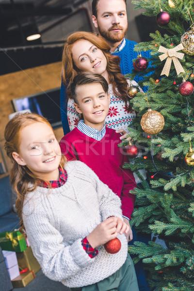 Stock photo: family decorating christmas tree