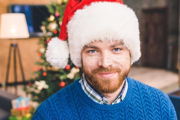 bearded man in santa hat Stock photo © LightFieldStudios