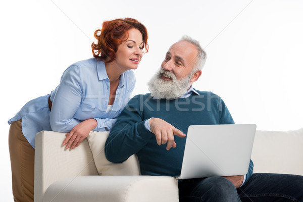 Mature couple using laptop Stock photo © LightFieldStudios