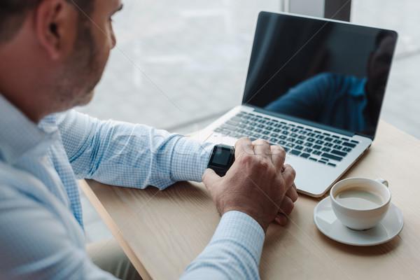 businessman checking time on smart watch Stock photo © LightFieldStudios