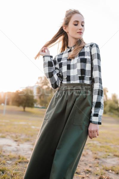 beautiful woman in autumn park Stock photo © LightFieldStudios