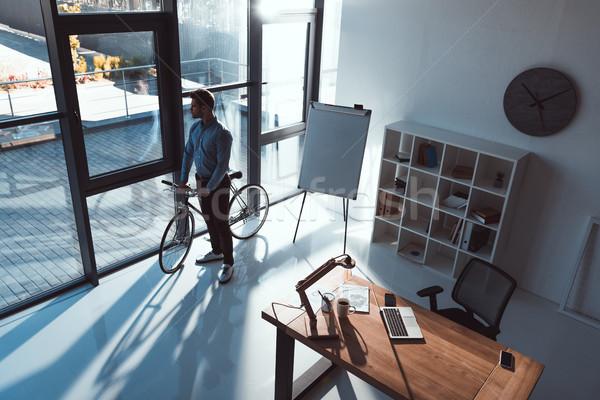 Işadamı bisiklet ofis görmek genç Stok fotoğraf © LightFieldStudios