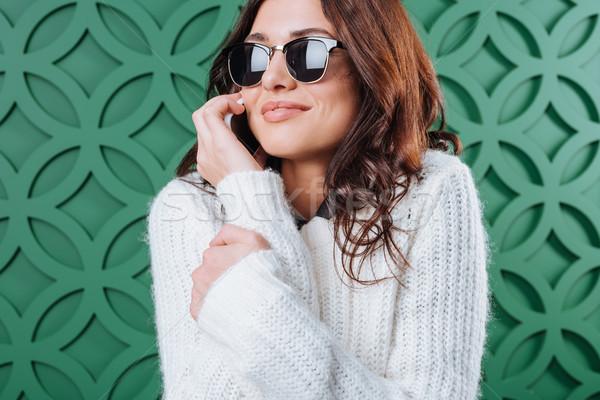 Donna maglione occhiali da sole parlando smartphone bella donna Foto d'archivio © LightFieldStudios