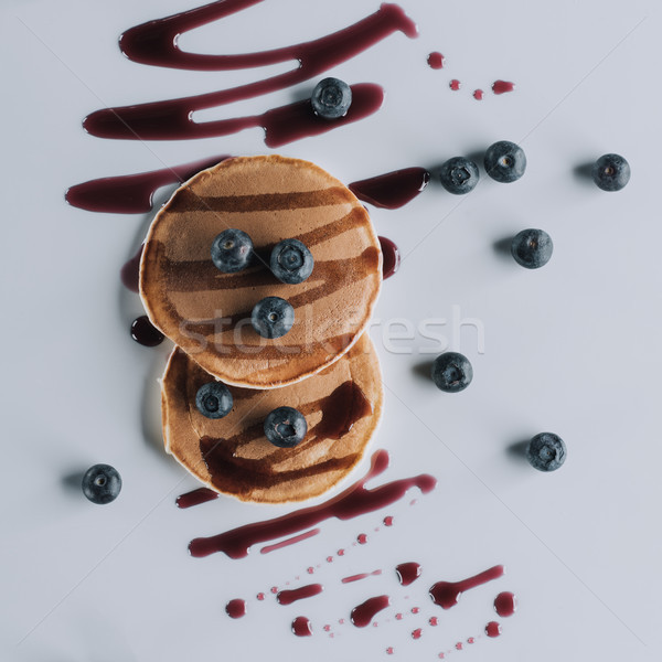 top view of tasty pancakes with fresh blueberries and jam on grey   Stock photo © LightFieldStudios