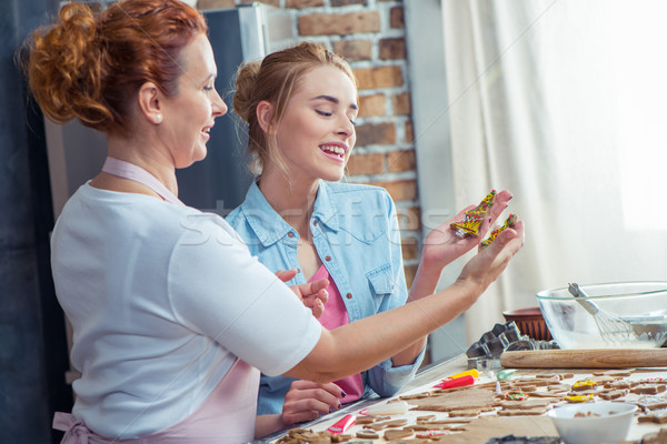 Stock photo: Mother and daughter making cookies