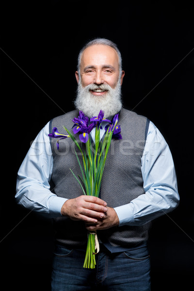 Senior man with flowers  Stock photo © LightFieldStudios