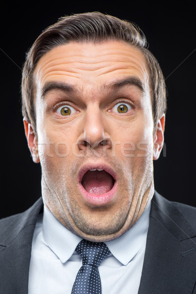 Young scared businessman Stock photo © LightFieldStudios