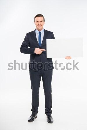 Işadamı boş kart gülen işaret bo Stok fotoğraf © LightFieldStudios