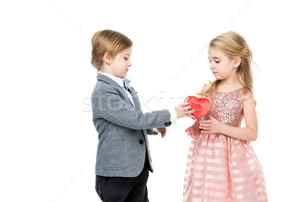Boy gives present to girl Stock photo © LightFieldStudios