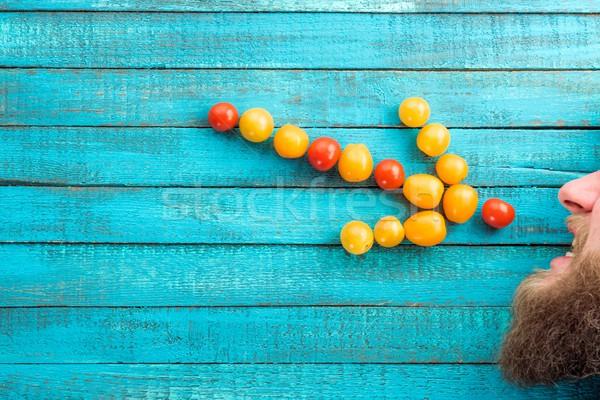 arrow made of cherry-tomatoes Stock photo © LightFieldStudios
