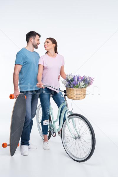 Pareja amor skateboard bicicleta blanco mujer Foto stock © LightFieldStudios