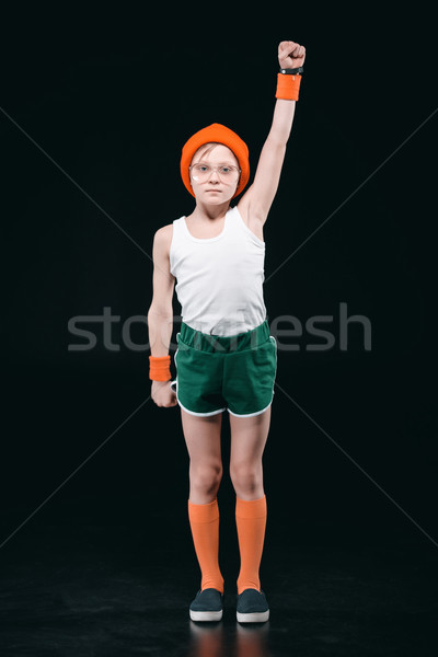 boy in sportswear exercising isolated on black. acting kids and athletics children concept  Stock photo © LightFieldStudios