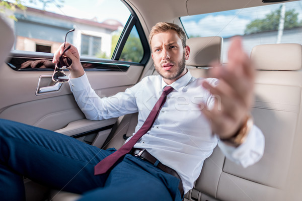 businessman on backseat of car Stock photo © LightFieldStudios