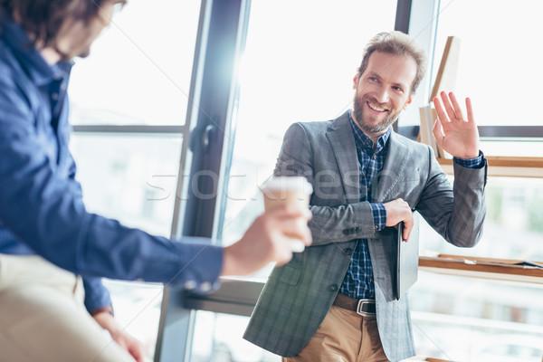 businessman waving hand to colleague Stock photo © LightFieldStudios