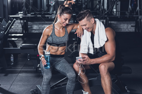 sportive couple with smartphone Stock photo © LightFieldStudios