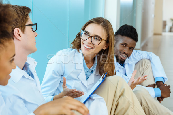 doctors sitting on floor in hospital Stock photo © LightFieldStudios